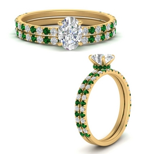 three-quarter-oval-shaped-diamond-gallery-bridal-ring-set-with-emerald-in-FD9168OVGEMGRANGLE3-NL-YG