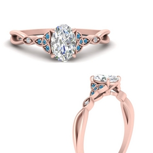 celtic-knot-split-oval-shaped-diamond-engagement-ring-with-blue-topaz-in-FD9609OVRGICBLTOANGLE3-NL-RG