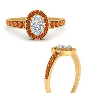 graduated-oval-halo-orange-sapphire-engagement-ring-in-FD9698OVRGSAORANGLE3-NL-YG-GS