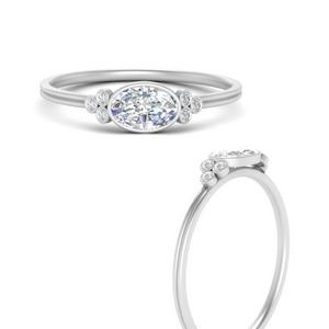 east-west-oval-bezel-cluster-delicate-diamond-engagement-ring-in-FD9983OVRANGLE3-NL-WG
