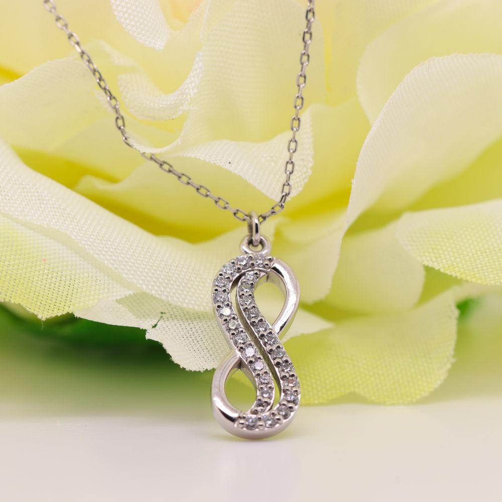 Infinity Diamond Pendant In 14K White Gold